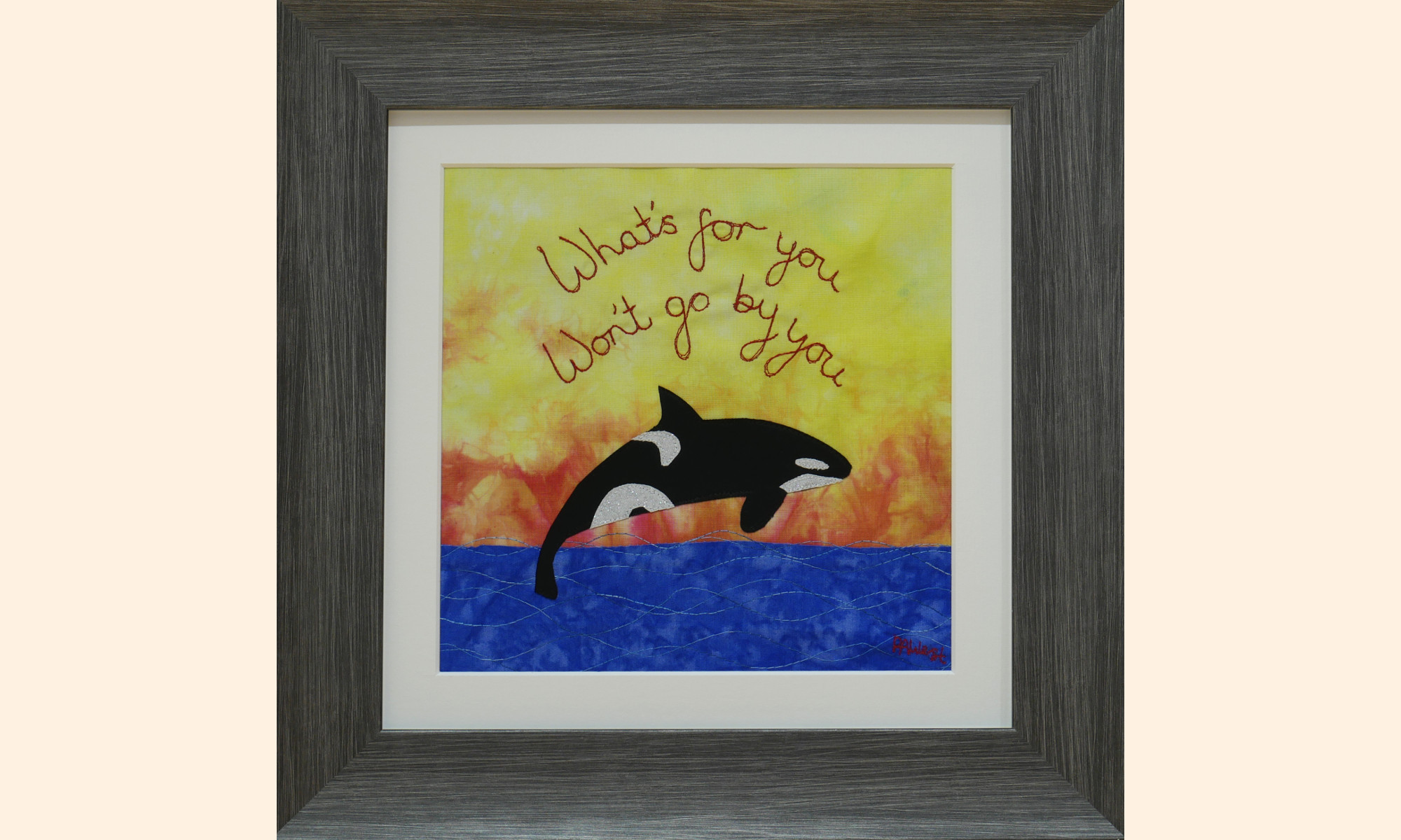 Framed picture of an Orca and sea on a bright background.