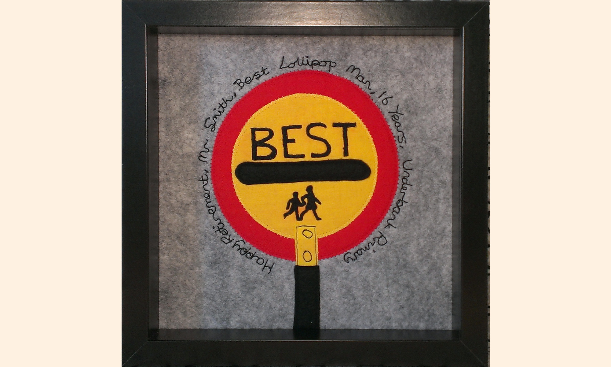 Framed picture, School crossing patrol lollipop with Best written on it.