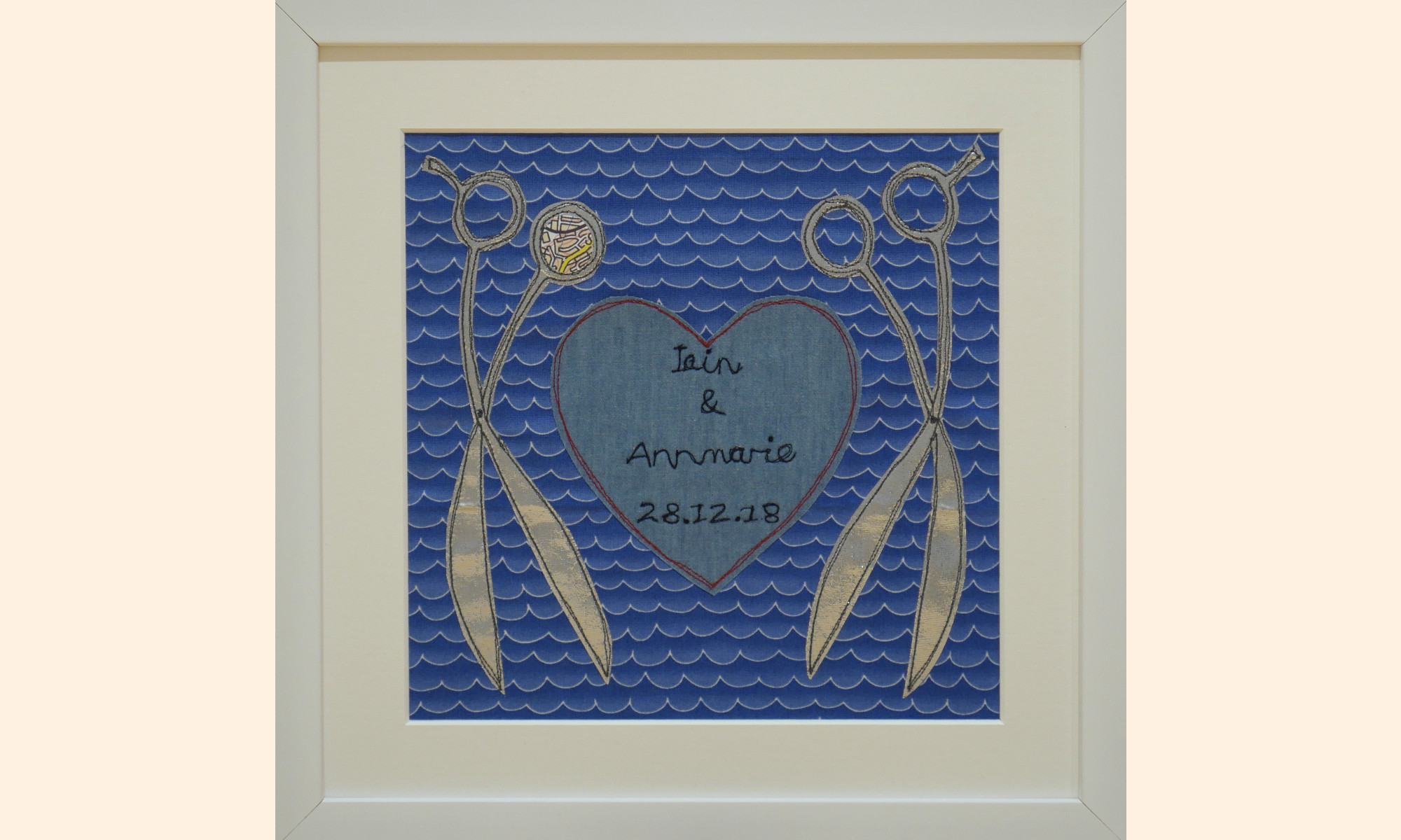 framed picture, 2 pairs of scissors around a love heart with the couples names on.